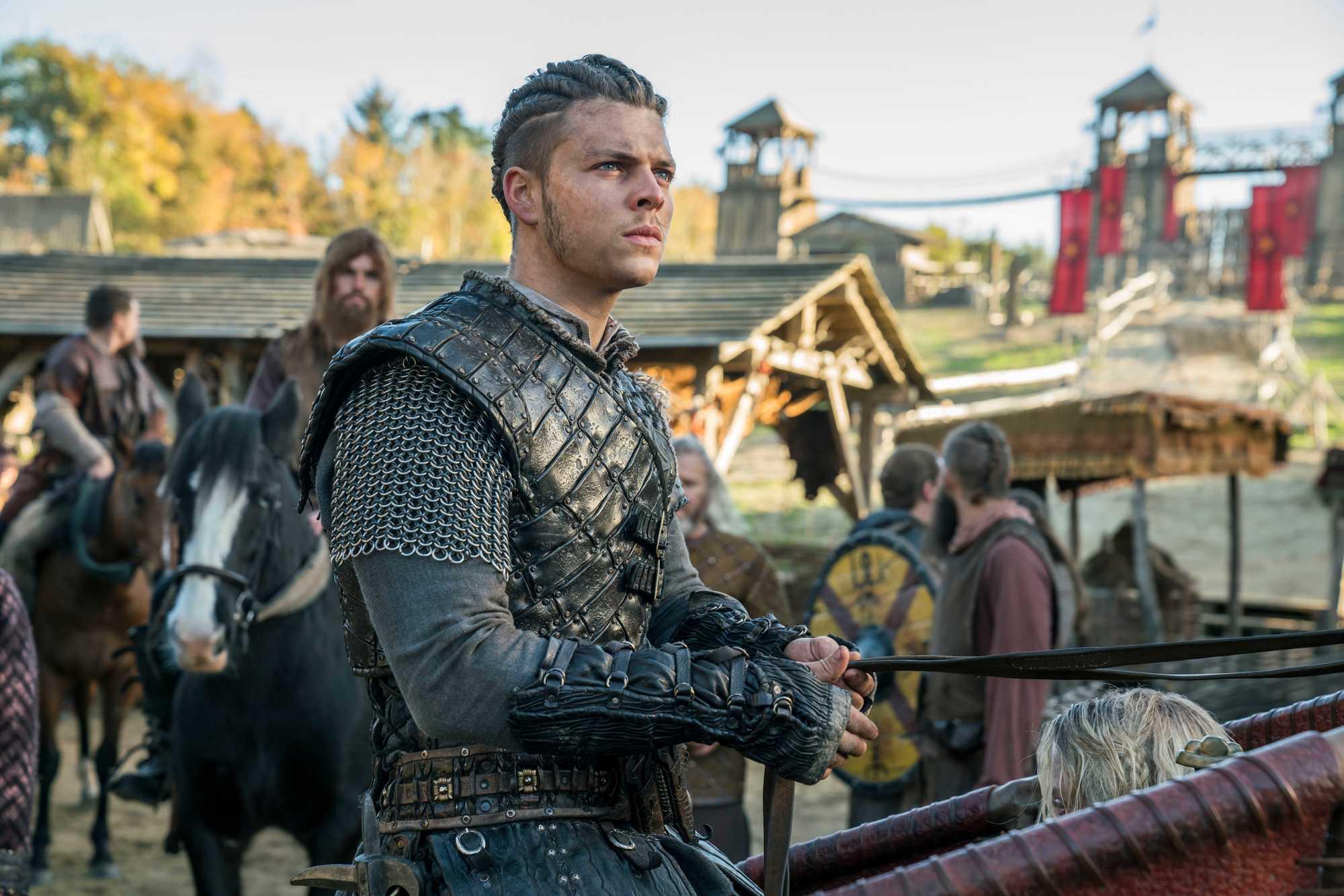 Viking Hairstyles: Vikings character with twisted back cornrows with undercut, wearing costume on set of Vikings