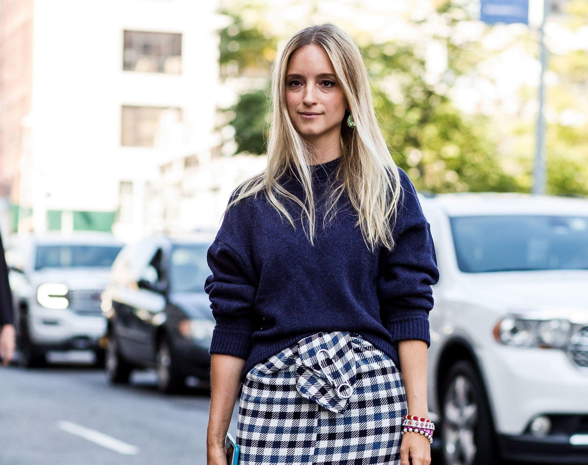 Purple conditioner for blonde hair: Blonde street style blogger with long straight hair wearing a navy jumper and checkered skirt
