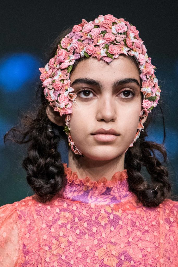 London Fashion Week SS19 Model at Bora Aksu with braided pigtails and pink floral embroidered net headpiece