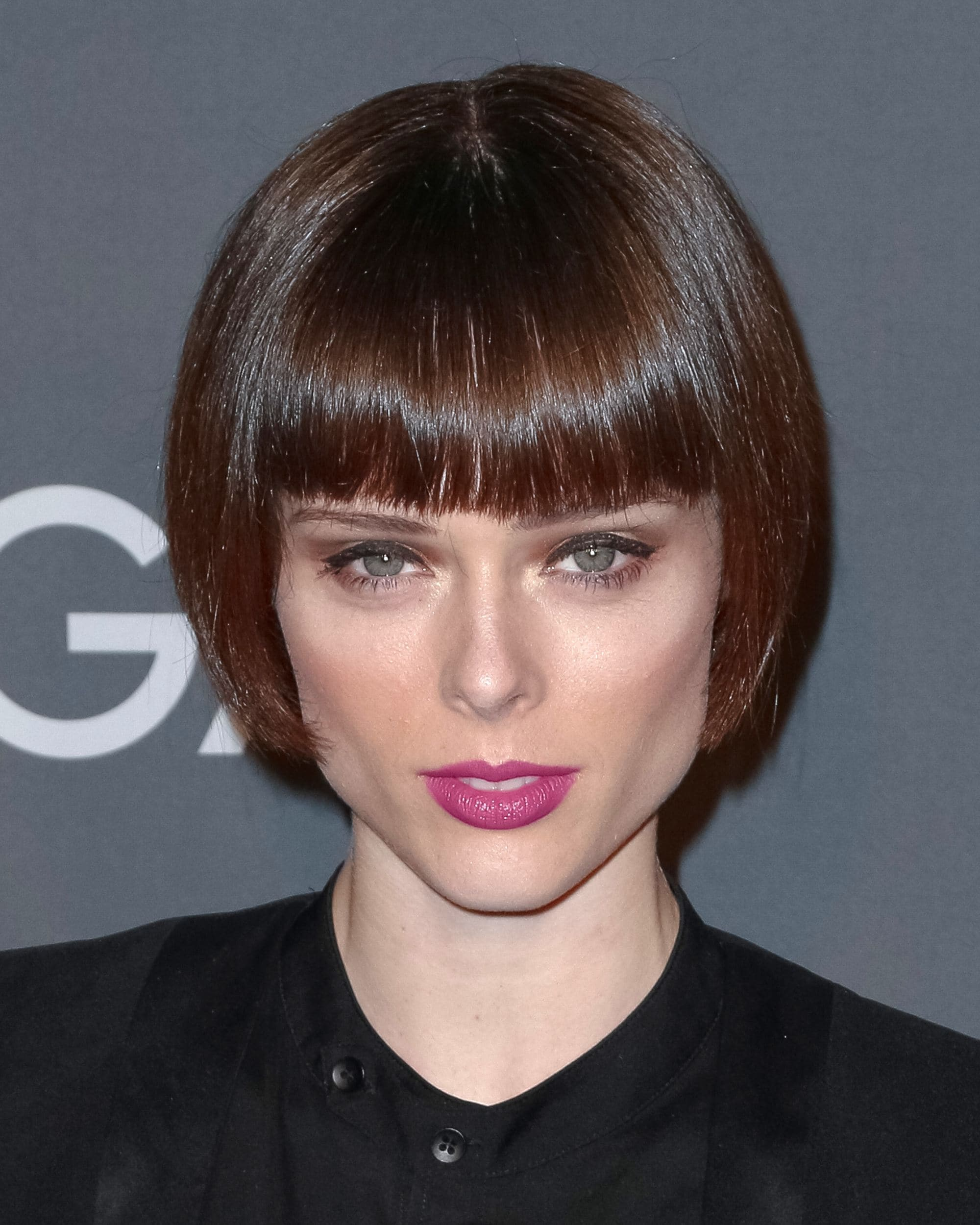 coco rocha with a dark brown straight bob with blunt full fringe