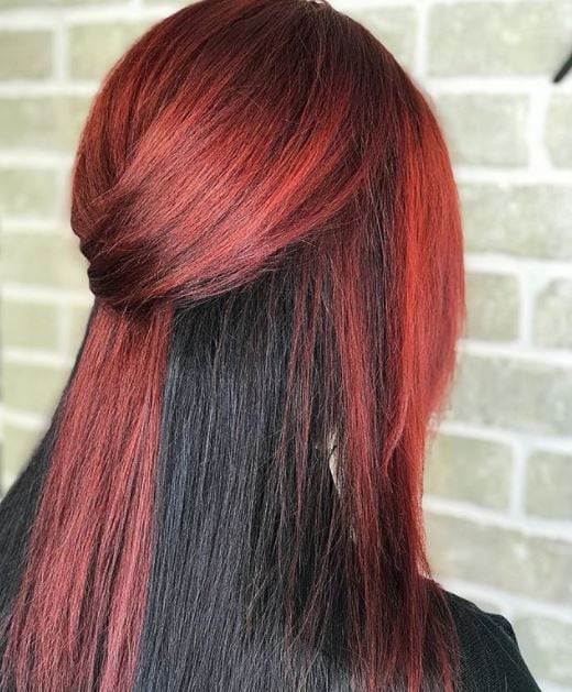 back view of woman with half red and half black straight hair