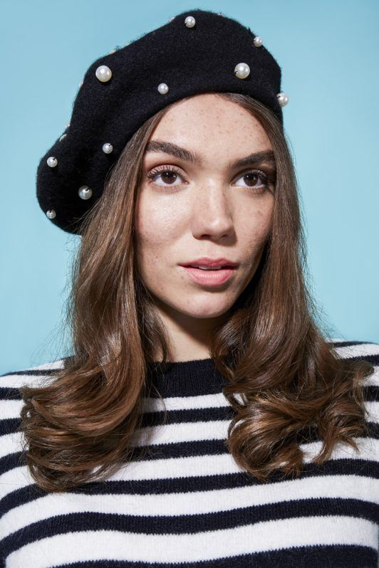 Brunette girl with beret and headband curls
