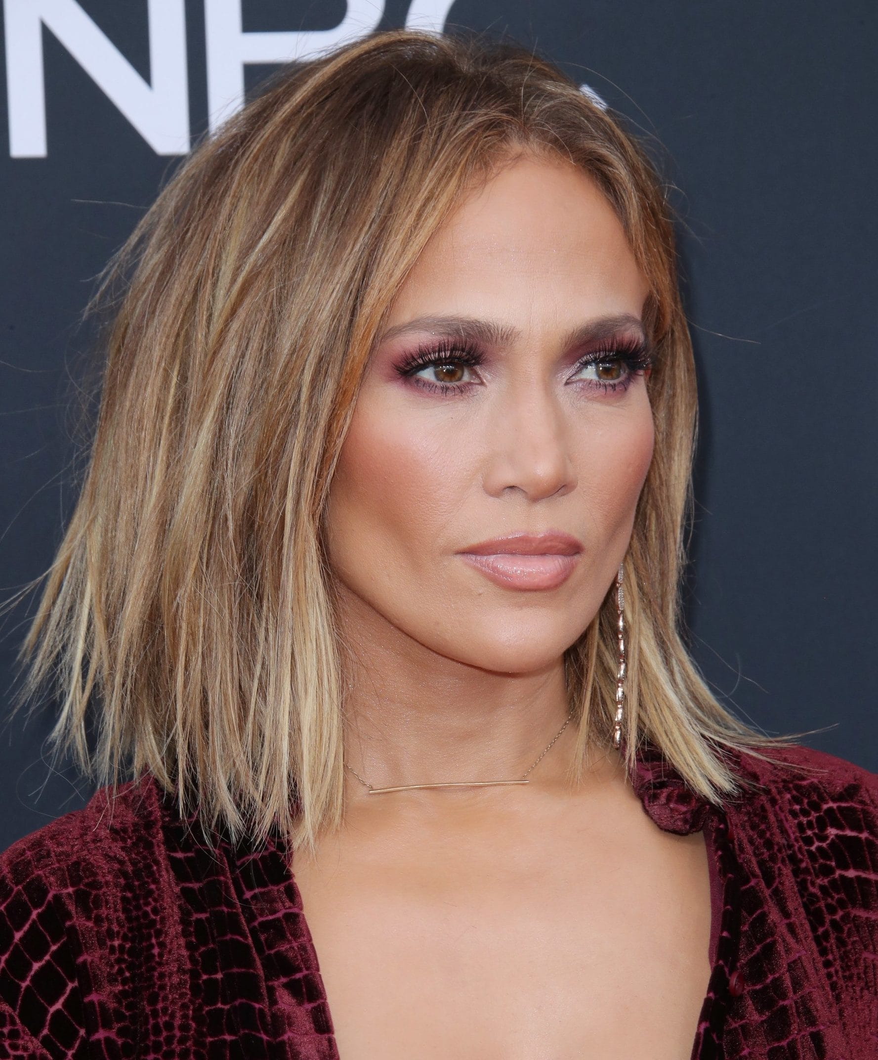 Brown hair with blonde highlights: Jennifer Lopez with a brunette and blonde highlighted bob, wearing a red outfit