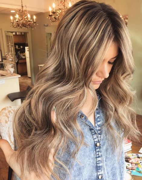 woman with long brown blonde lowlights way hair