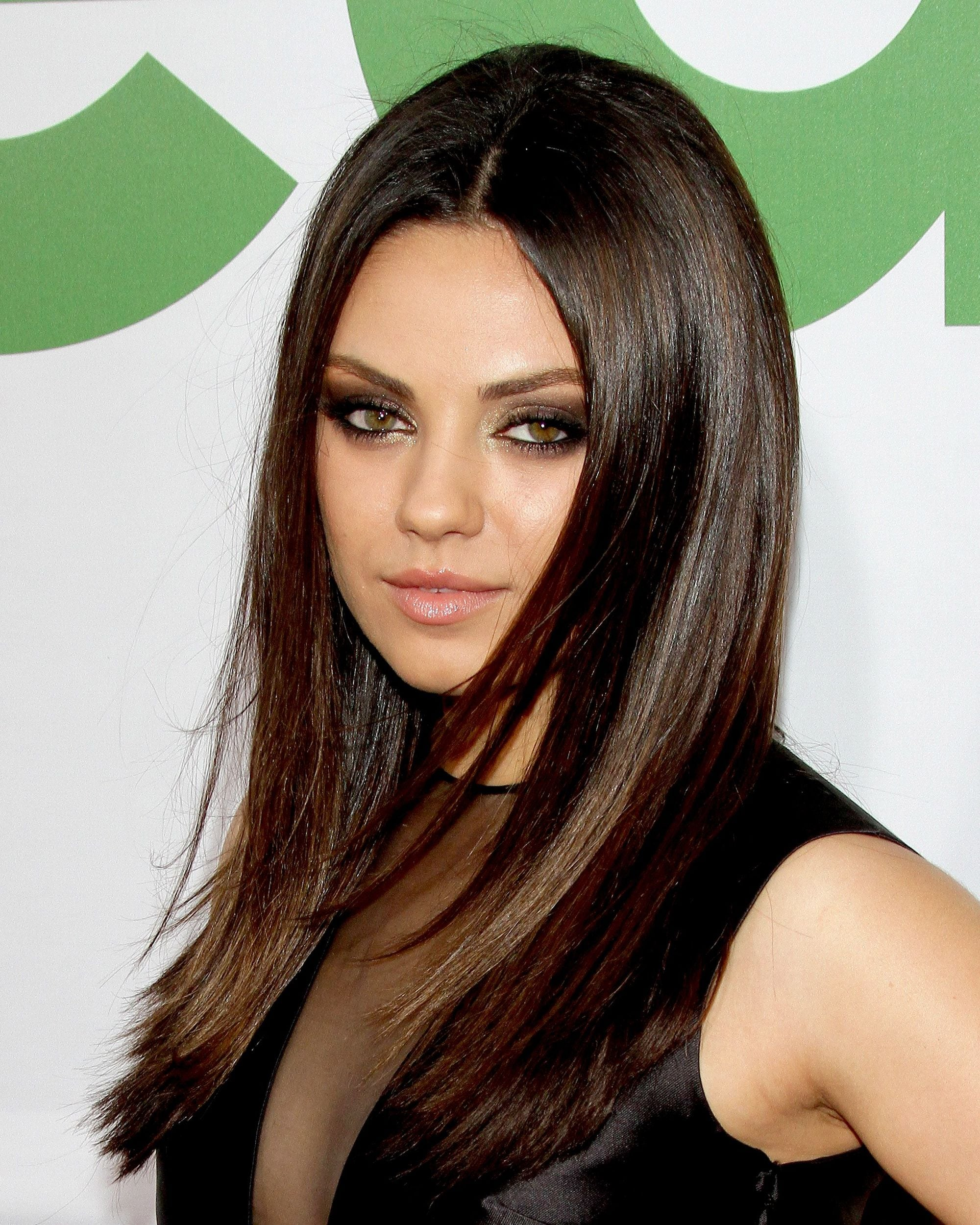 actress mila kunis with long dark straight hair with long layers