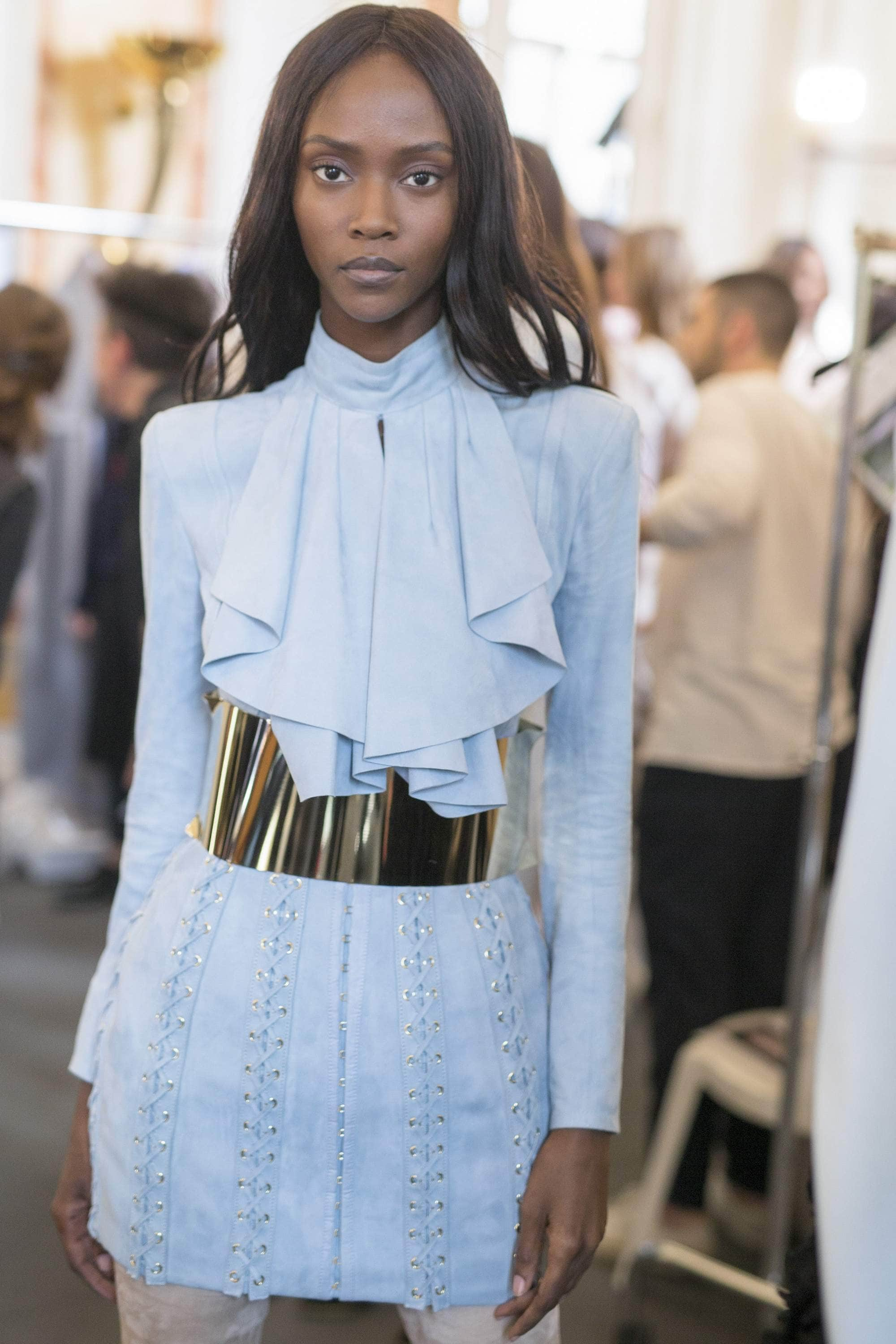 What is a weave black model with long hair backstage at Balmain show