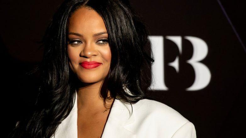 Rihanna with dark brown long weave
