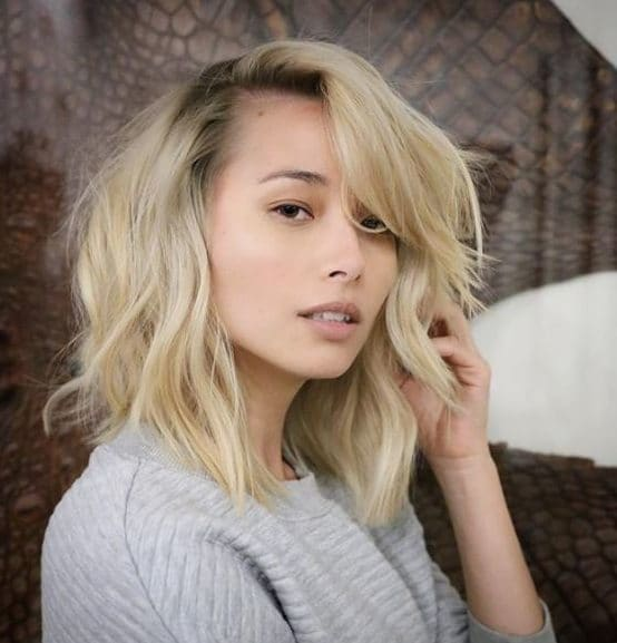 woman with blonde long bob with side bangs
