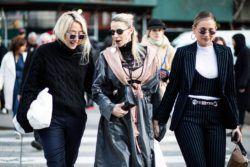 Three blonde women at fashion week walking outside