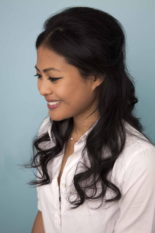 woman with dark brown medium length wavy hair half-up bouffant