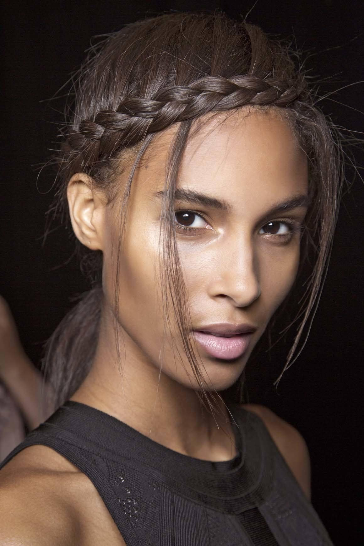 Black model backstage with braid and tendrils what is a weave