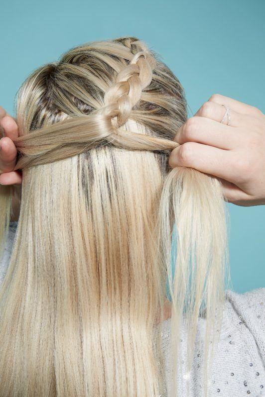 Blonde woman braiding hair to create flower braid
