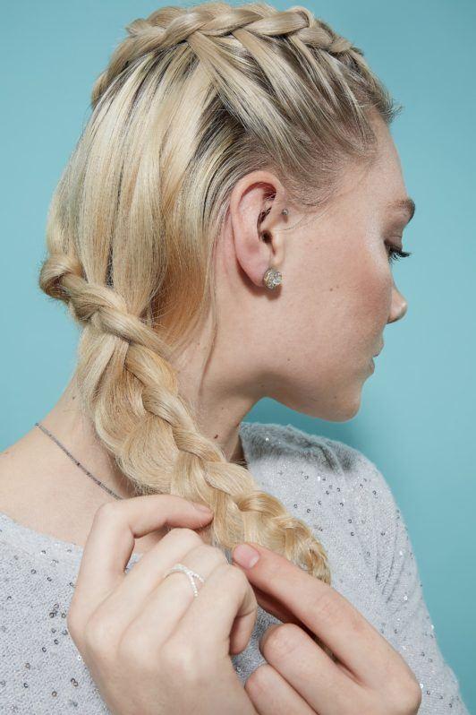 Blonde woman pancaking hair to create flower braid