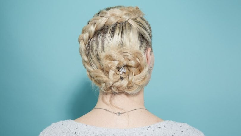 Blonde woman back of head with flower braid