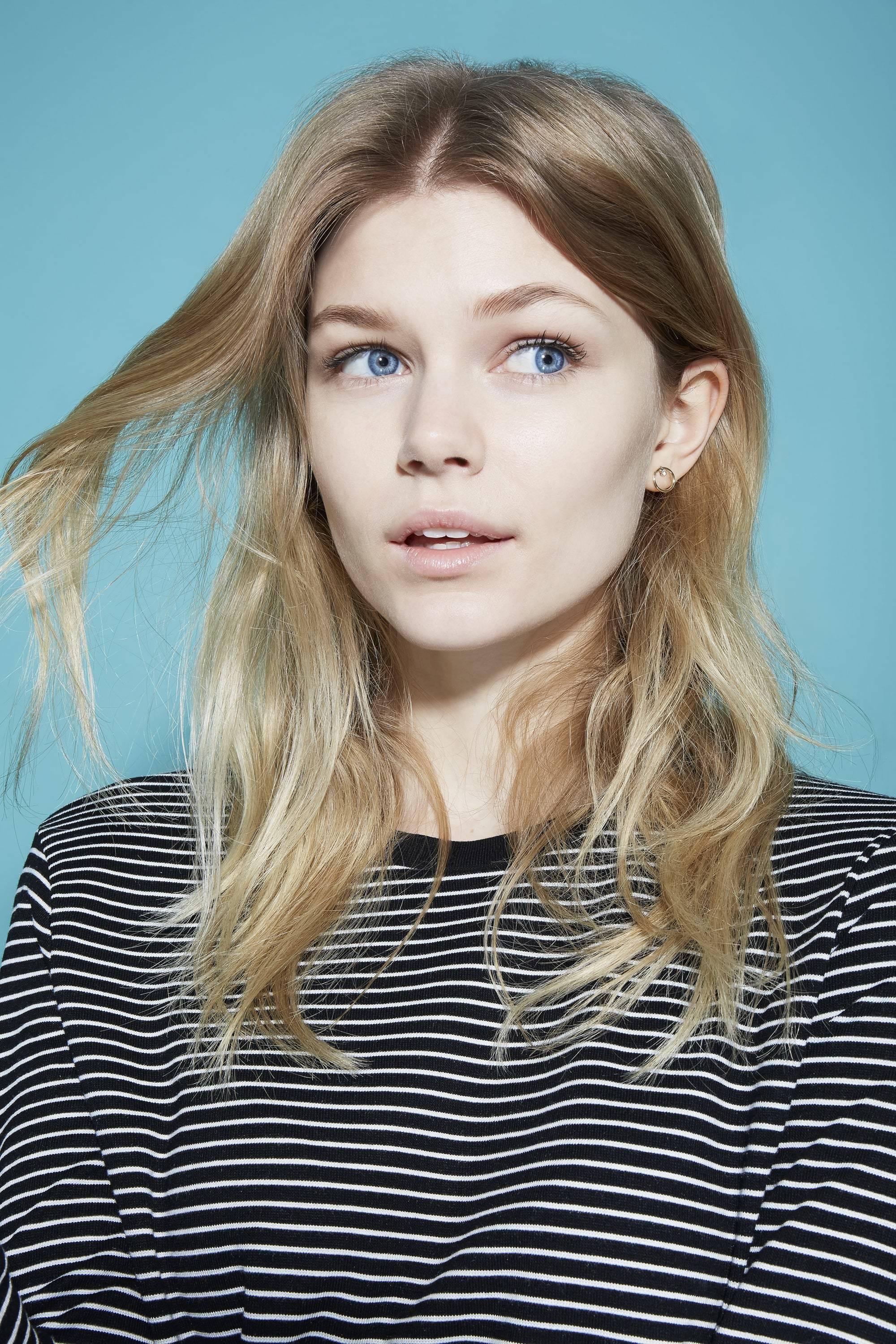 Blonde woman holding hair split ends