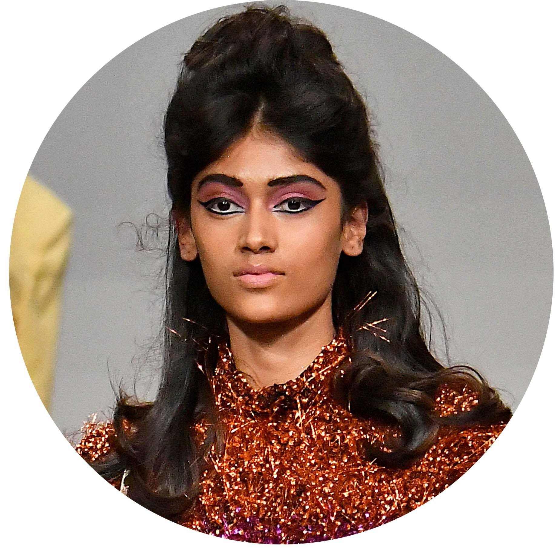 model at the ashish london fashion week aw18 with 60s brigitte bardot beehive hair