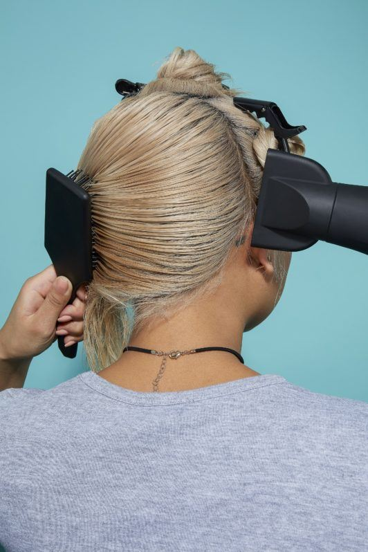 How to blow dry short hair blonde woman with hairdryer