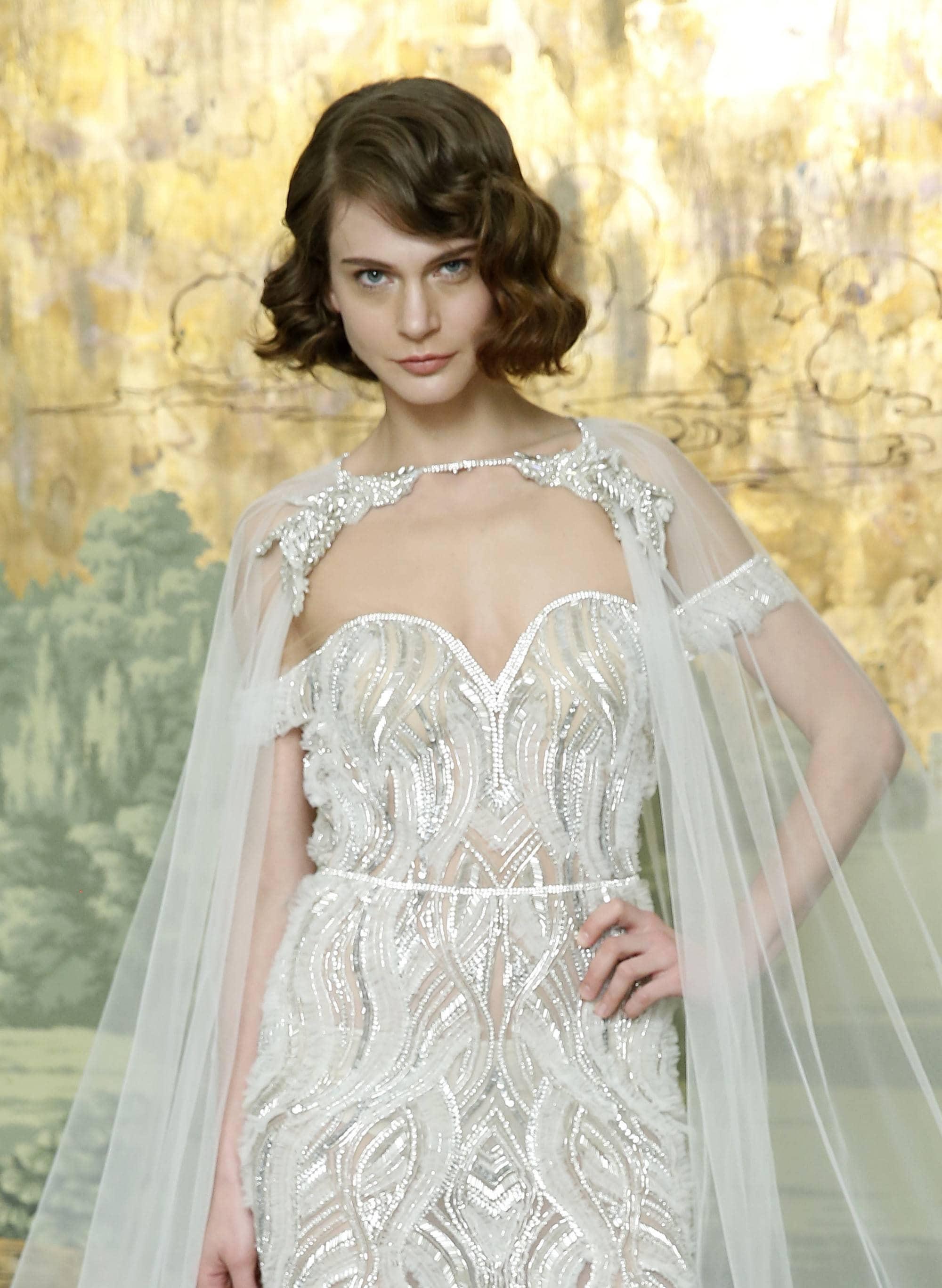 Curly wedding hair: Brunette bridal model with bob length '20s inspired finger waves