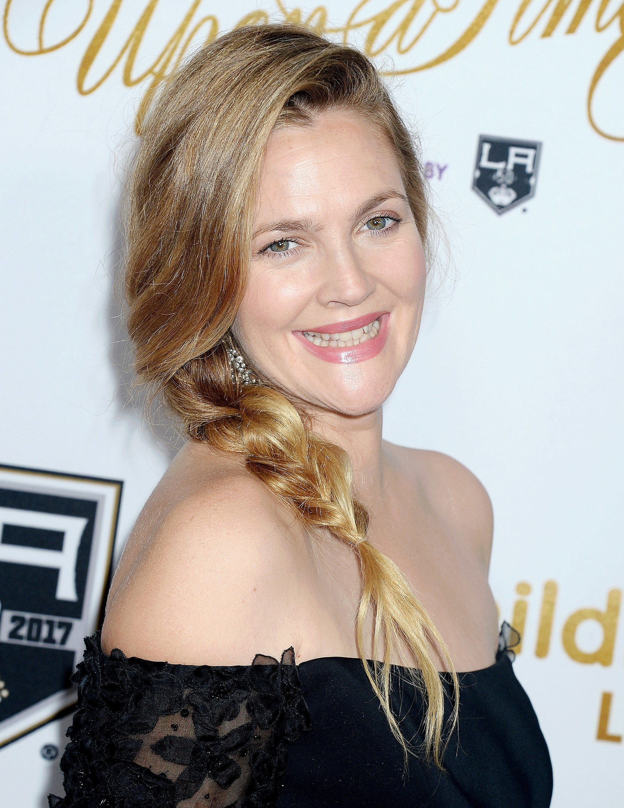 Side braid hairstyles: Drew Barrymore with long blonde side rope braid wearing a off the shoulder top.