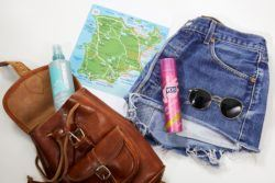 flatlay of adventure holiday hair essentials