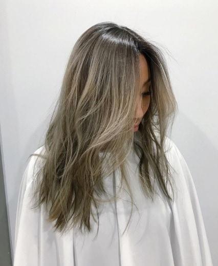 asian woman with dark grey silvery hair with darker dark brown lowlights