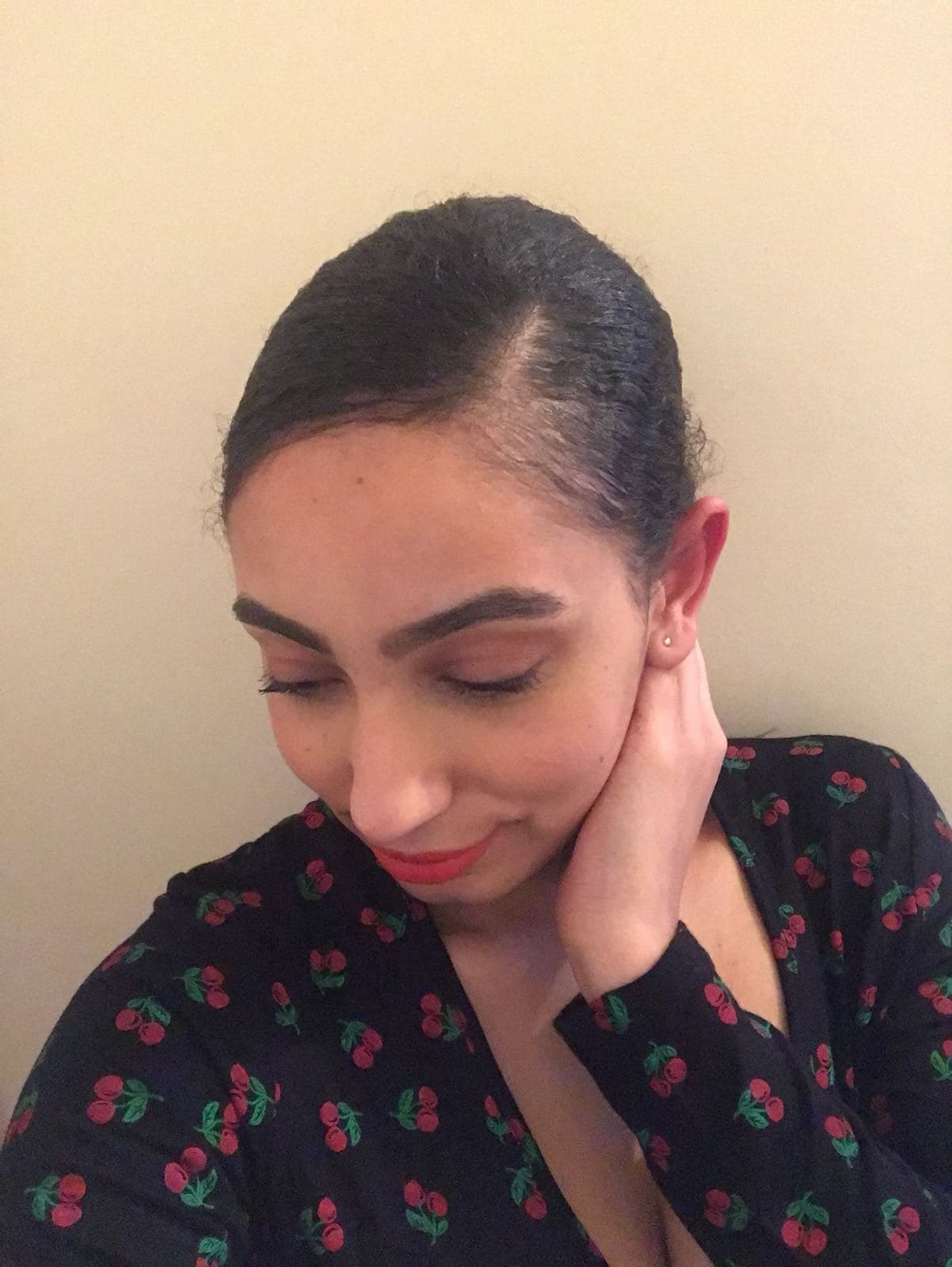 all things hair junior beauty editor amra with a slick side parting and low bun