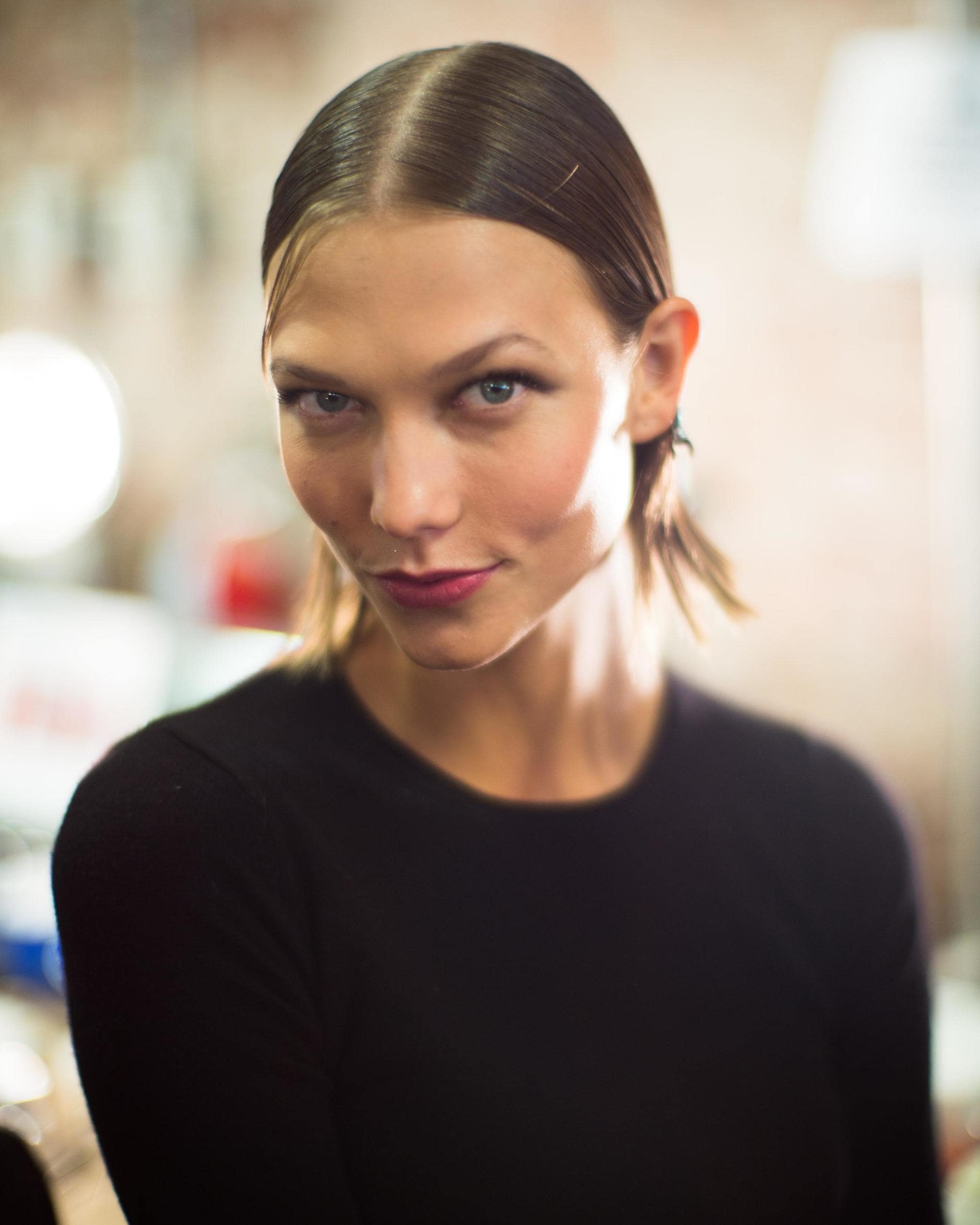 karlie kloss backstage at jason wu spring 2014 runway show with blonde bob hair in middle parting wet look style