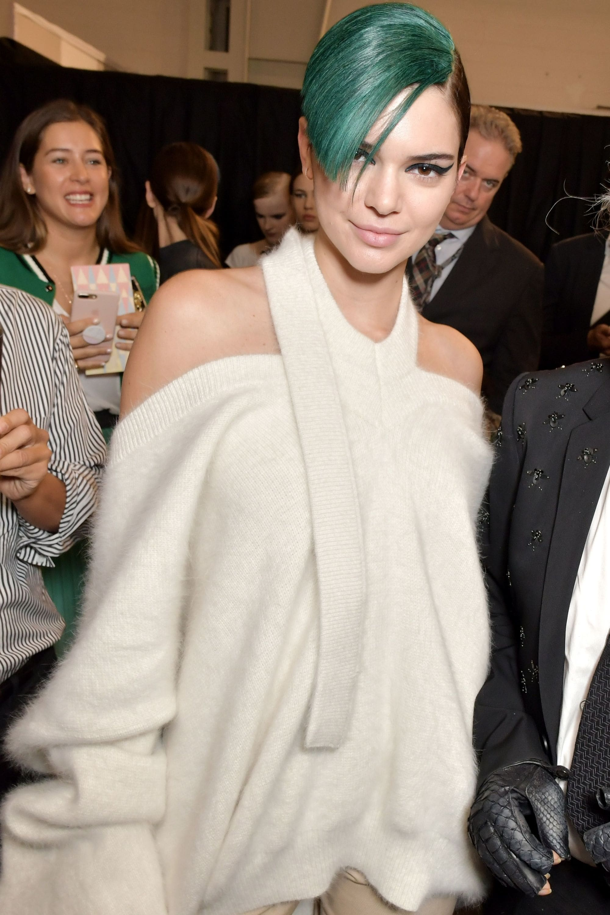 Green hair: Kendall Jenner with dark green fringe at Fendi show wearing a white outfit.
