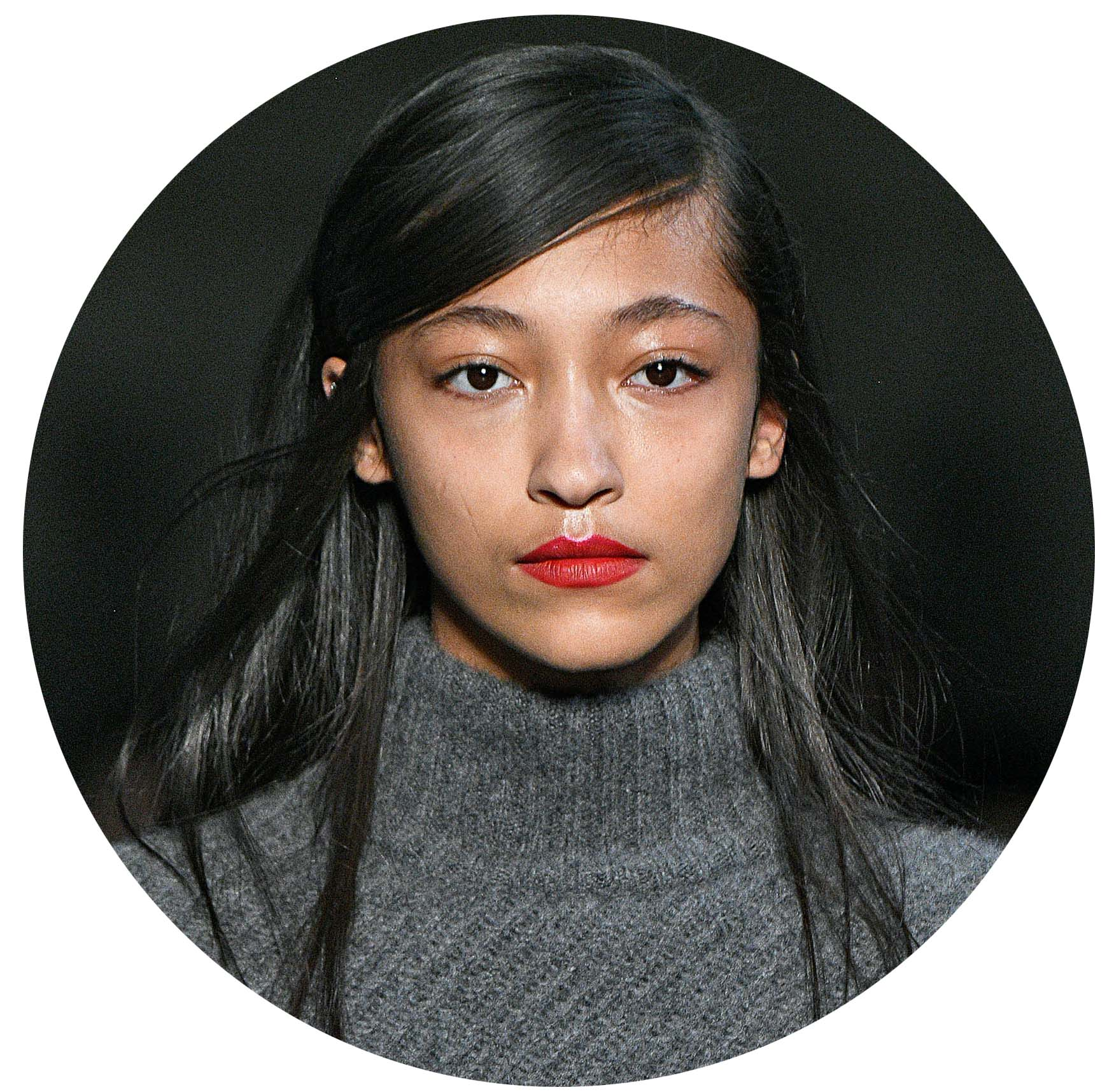 runway model at the nyfw sally lapointe show with long sleek straight black hair with a deep side parting