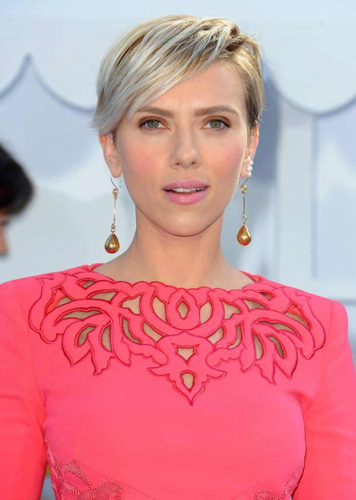 Pixie cut with bangs: Scarlett Johansson with a silver blonde pixie cut with side fringe, wearing a pink dress