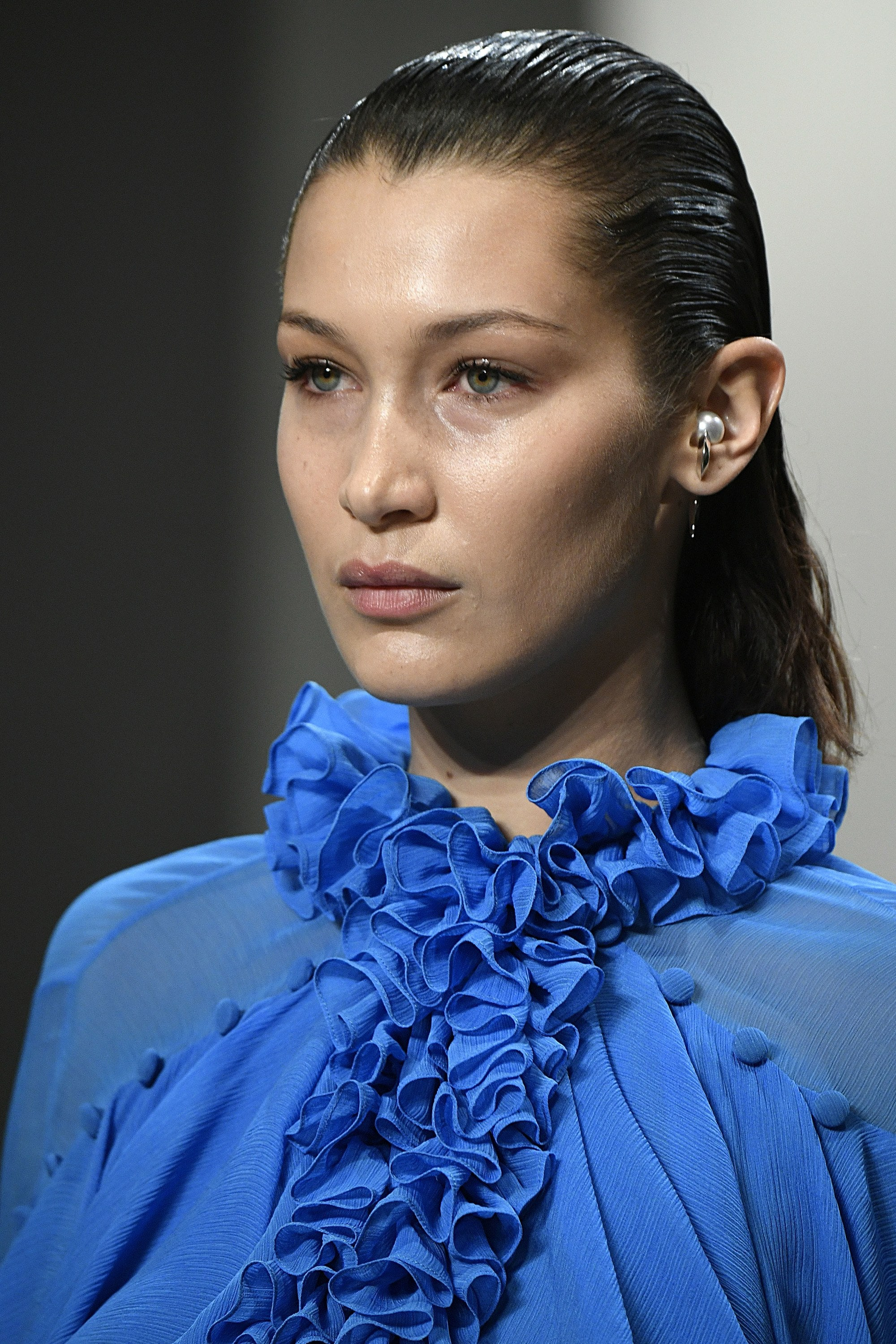 bella hadid dark brown wet look smoothed back hair on runway