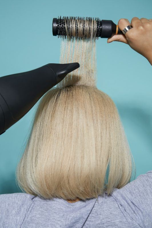 How to blow dry short hair blonde woman back of head