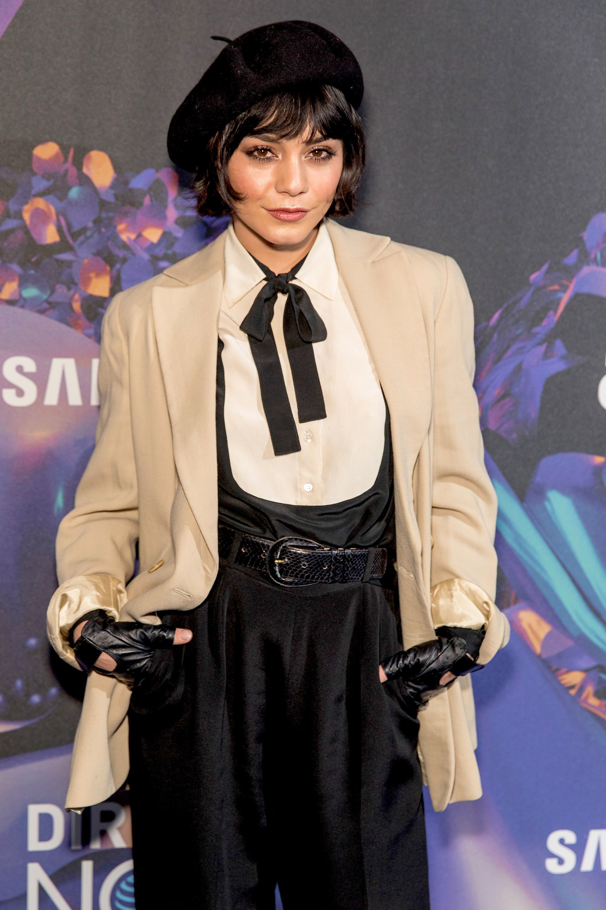 vanessa hudgens with dark brown bob and bangs chanel haircut with black beret and suit