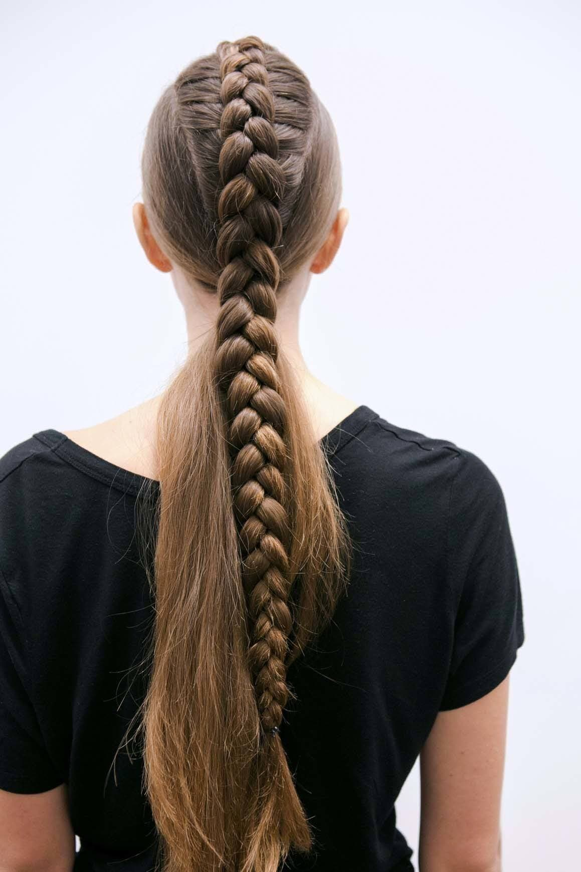 Woman with long brunette hair in a braid