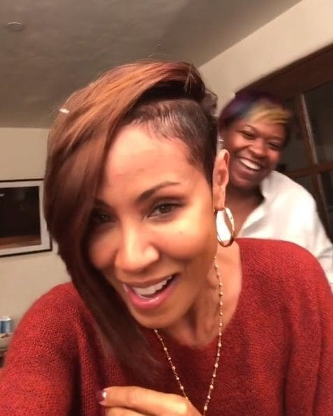 actress Jada Pinkett Smith in the salon chair with her stylist with a honey brown pixie cut with a shaved undercut