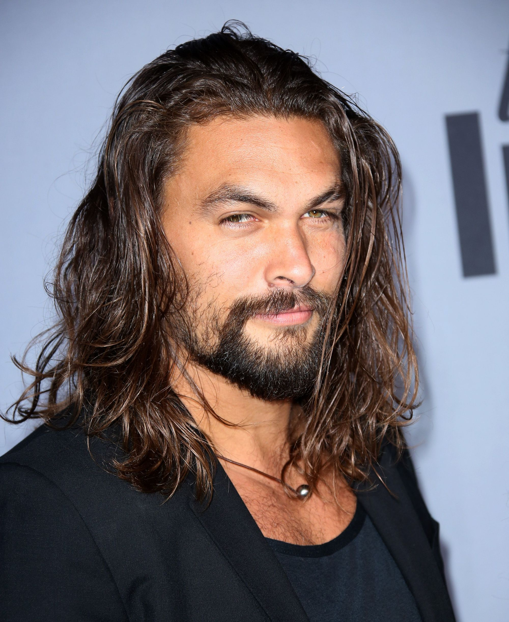 game of thrones actor jason momoa with long wild dark hair and heavy facial hair