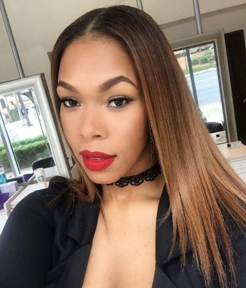 woman with golden brown relaxed straightened hair wearing red lipstick