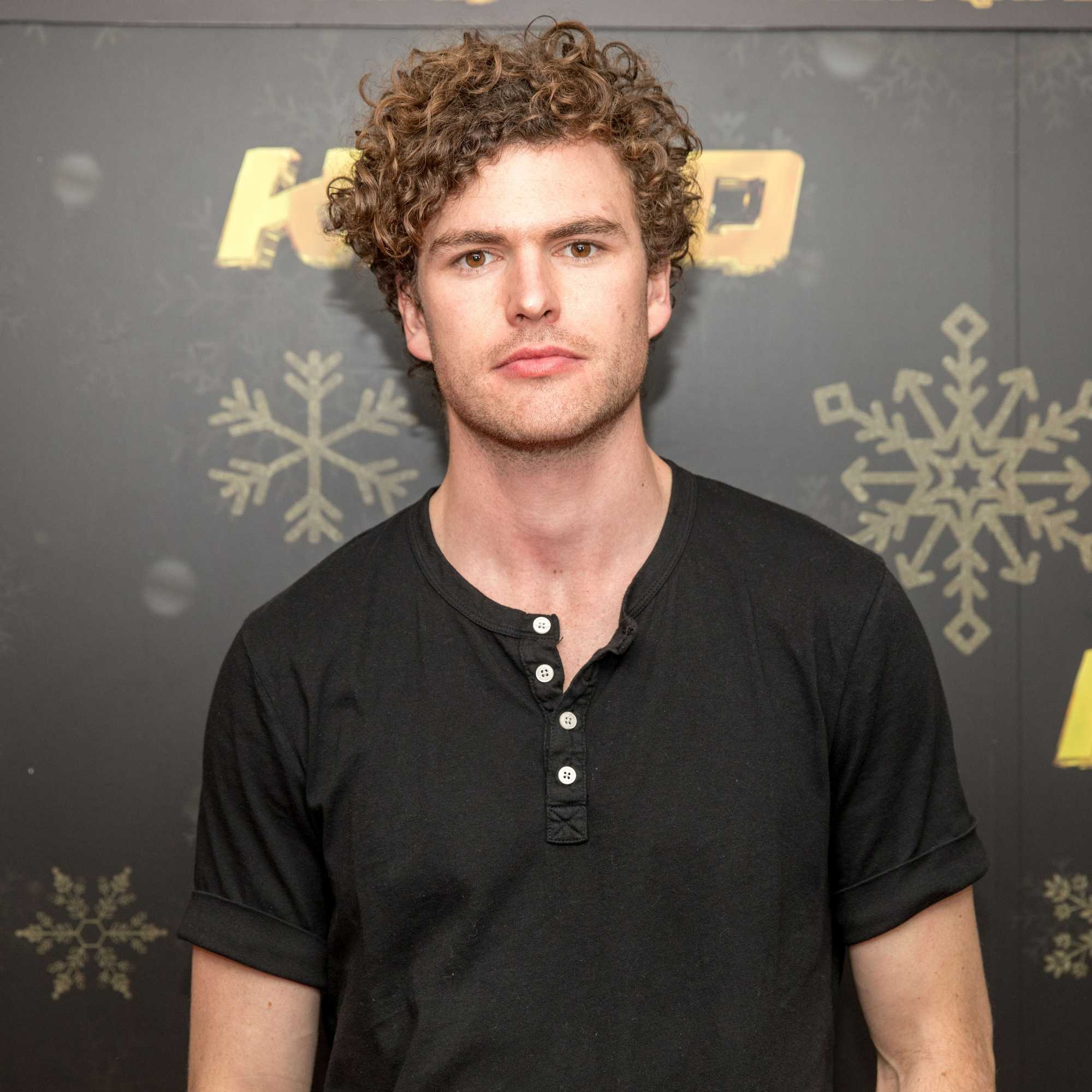 australian singer/songwriter vance joy with his short curly light brown hair