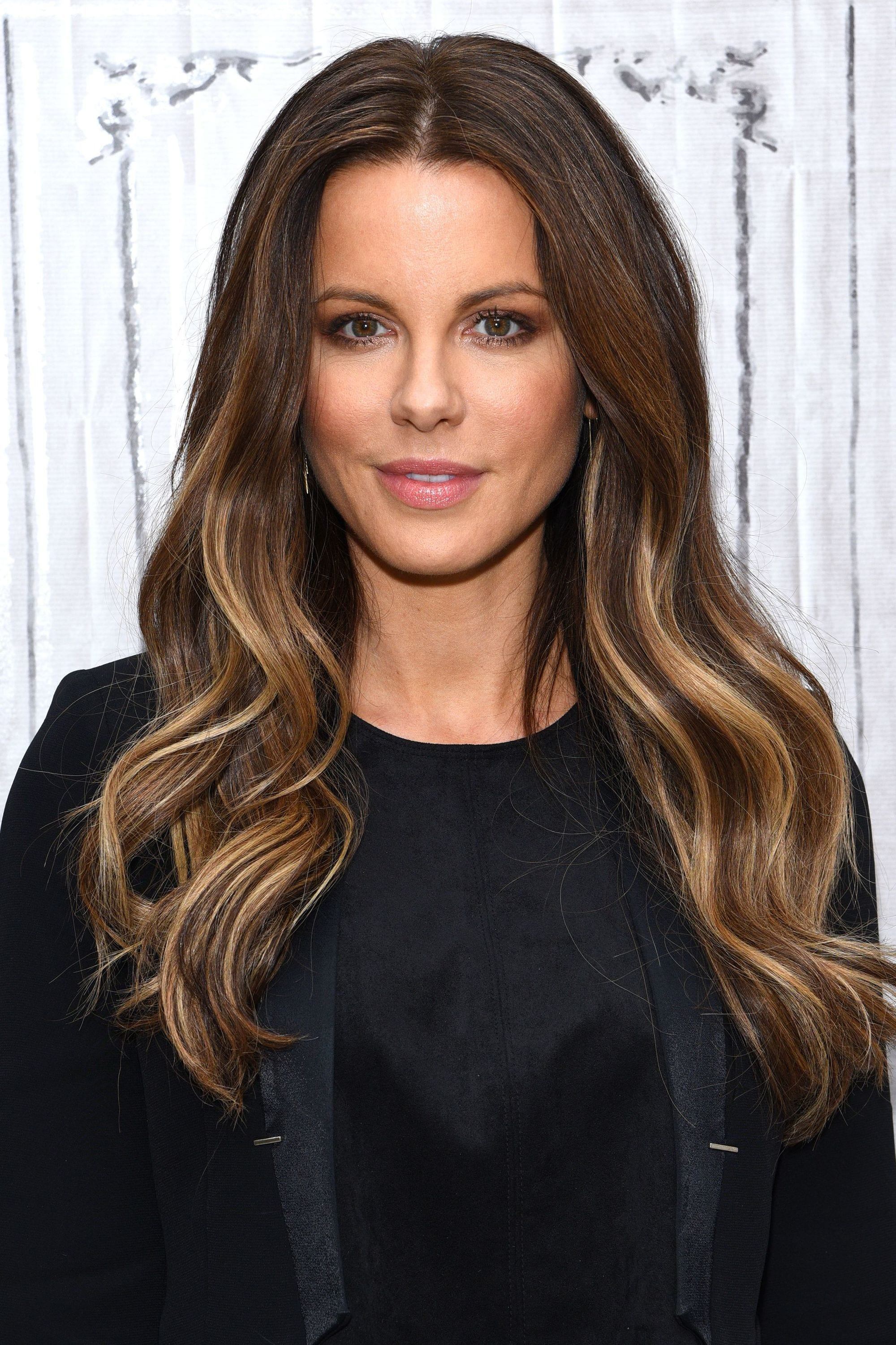kate beckinsale with long wavy brunette hair with darker and lighter highlights and lowlights