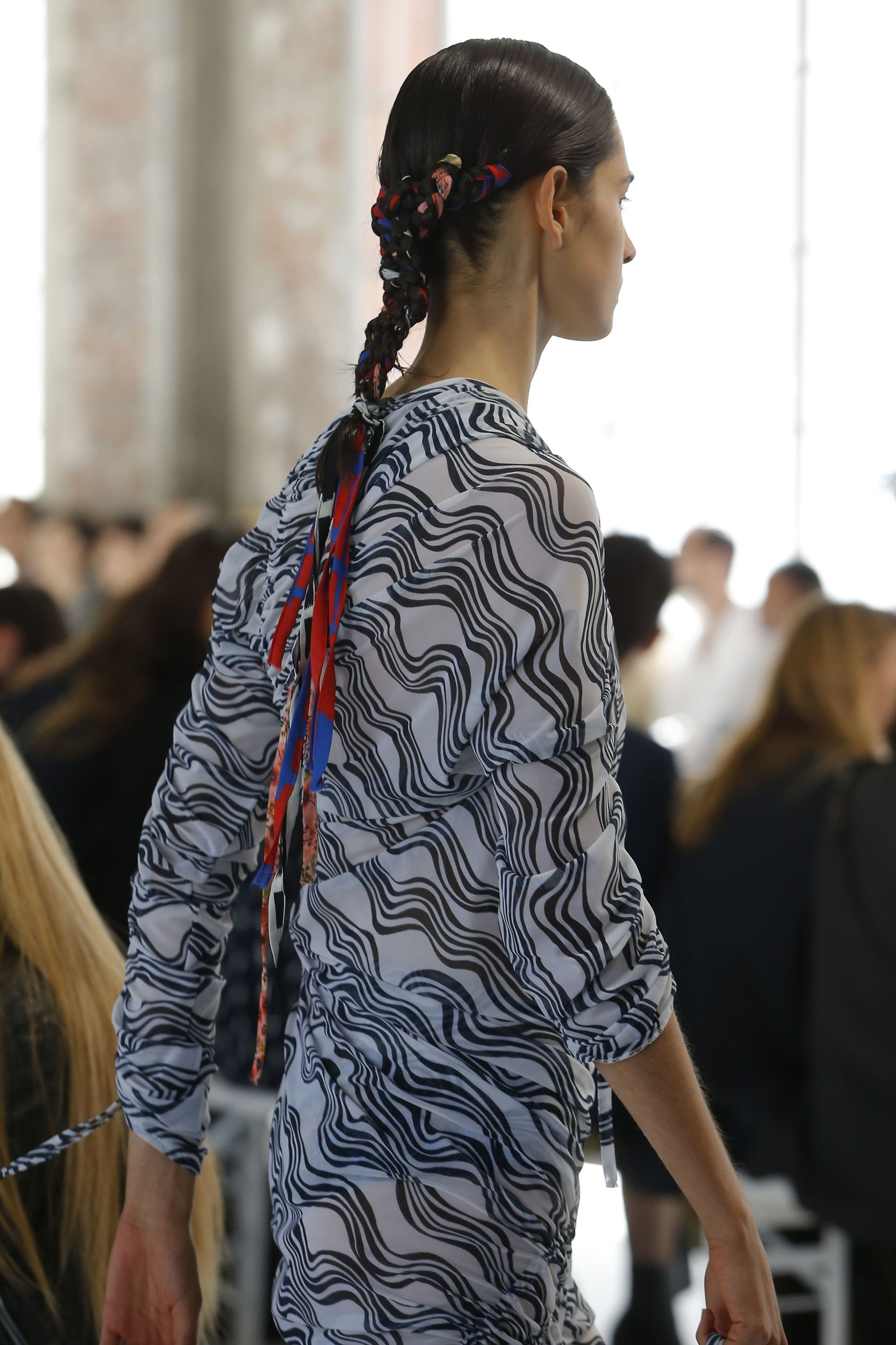Headband and bandana hairstyles: Model with long brown hair in scarf braid on Atlein SS19 runway.