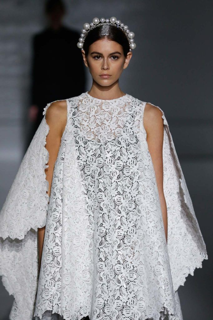 Haute Couture SS19; Kaia Gerber on Givenchy runway SS19 with brown hair in smooth low bun with jewelled tiara headband.
