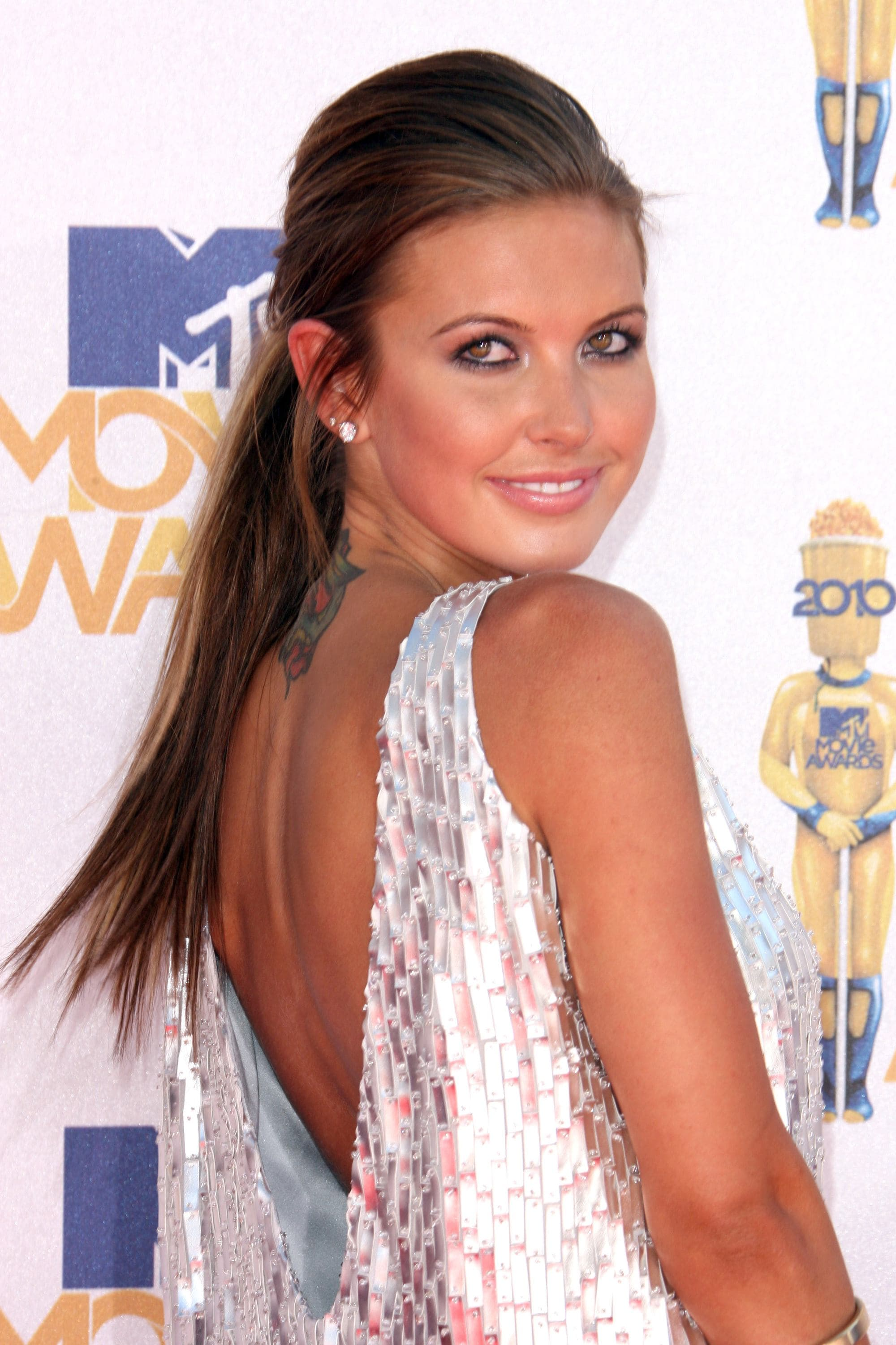 Audrina Patridge from MTV's The Hills on the red carpet with her dark brunette hair in a long straight ponytail