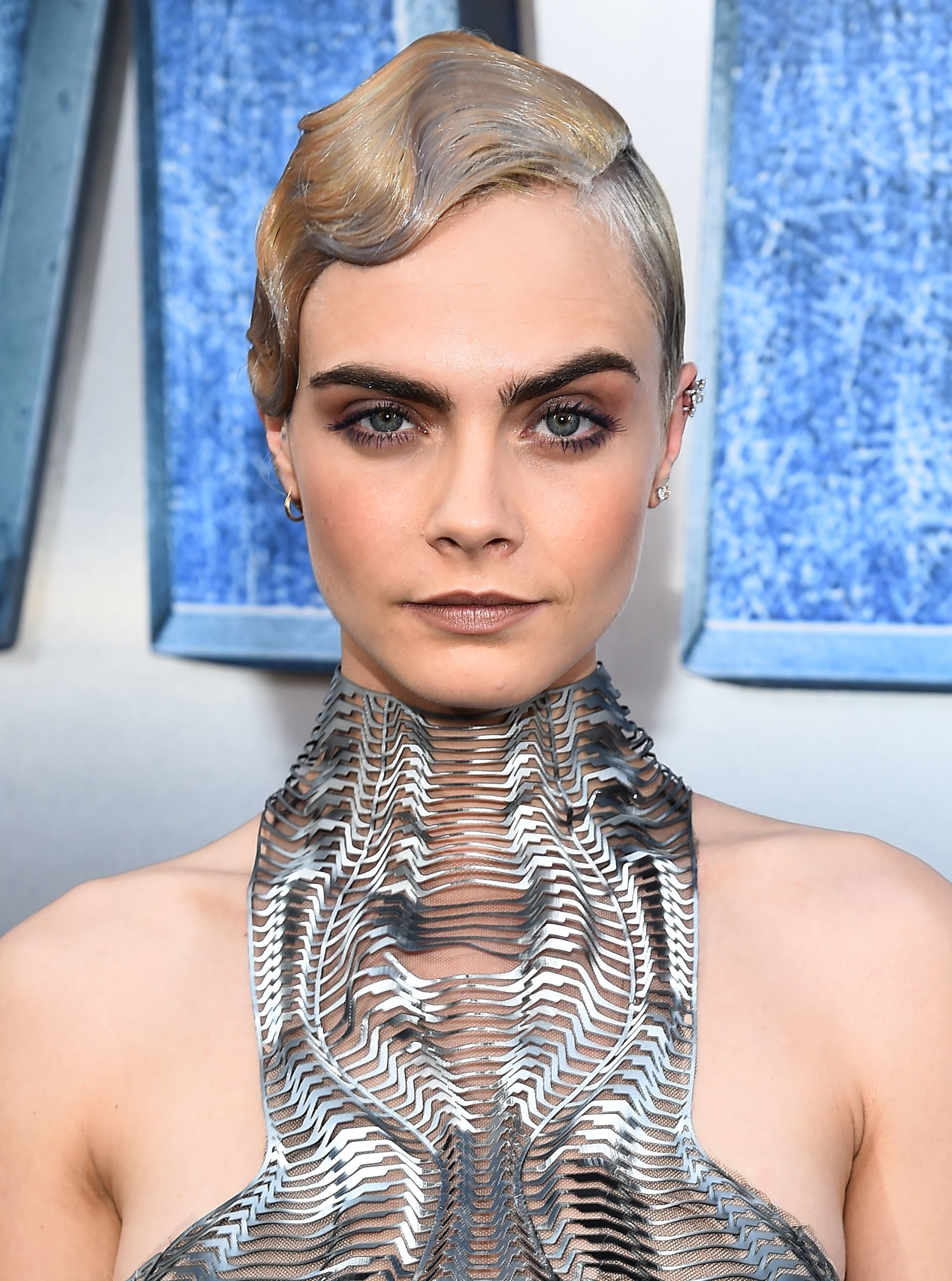1930s hairstyles: british model cara delevingne with a finger wave pixie cut