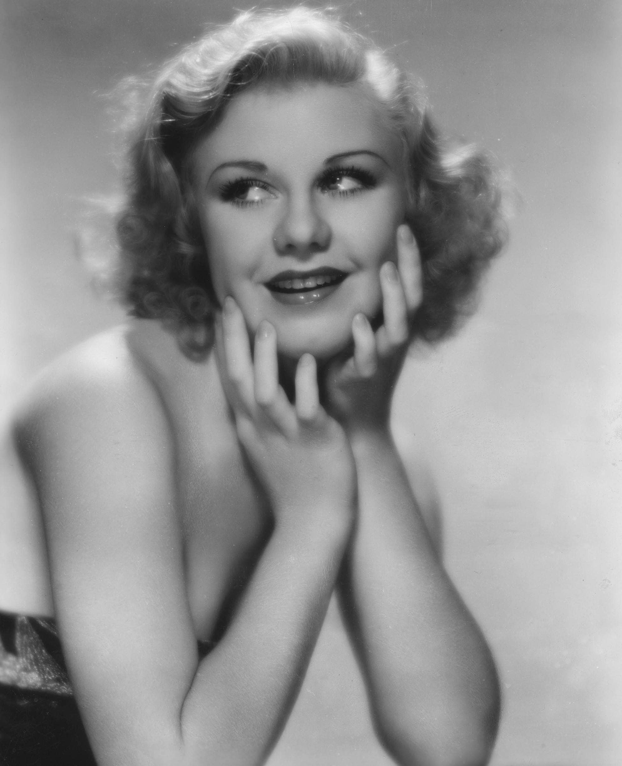 1930s hairstyles: Ginger Rogers bob length wavy vintage hair in black and white promo picture