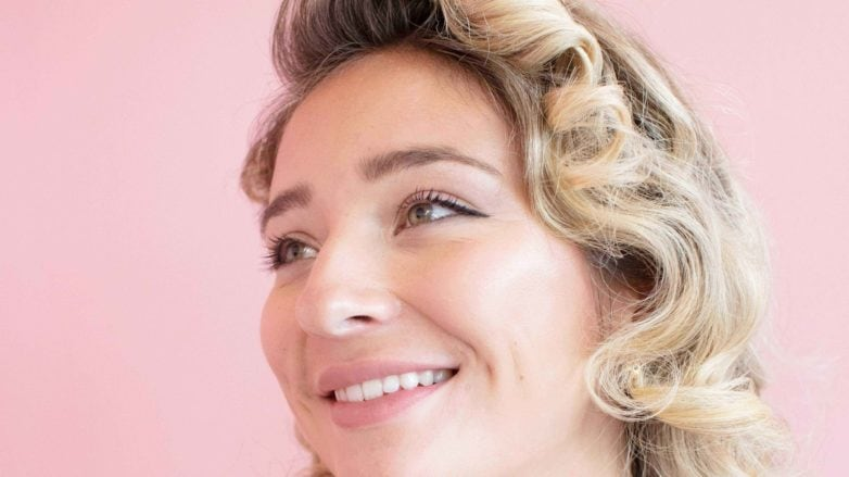 Woman with retro curly blonde hair