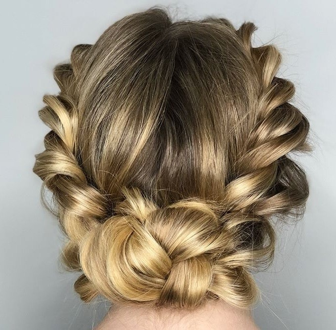Crown hair: Close up shot of a woman with golden blonde hair styled into a rope twisted crown braid