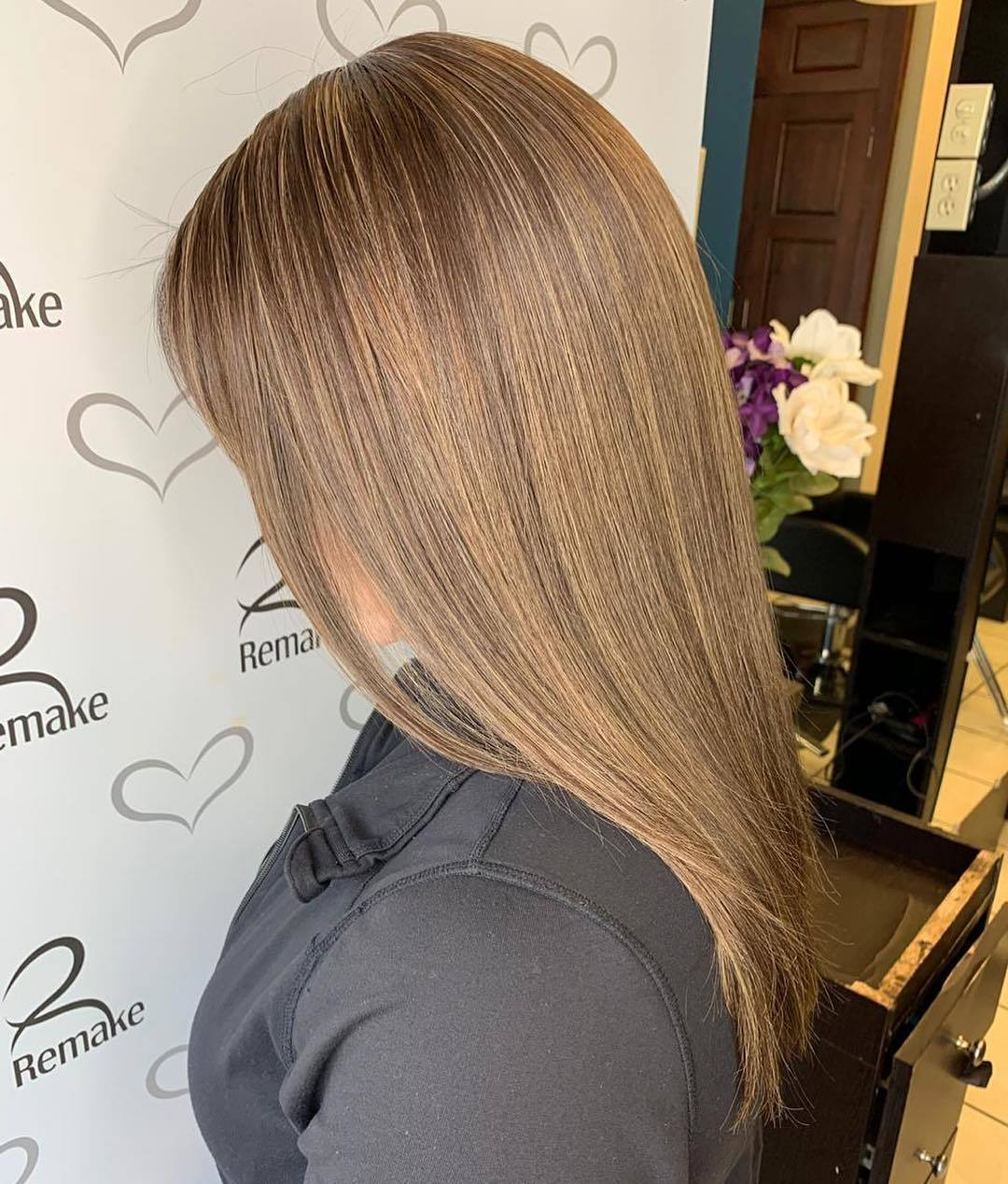 Shot of woman in a salon with long and straight caramel hair