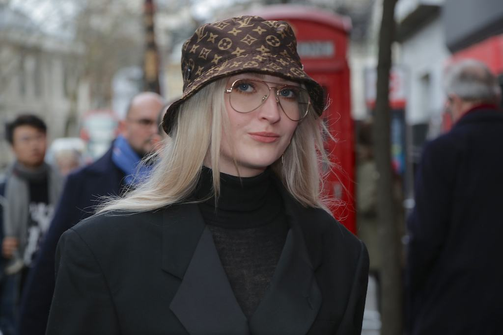 LFW hair street style: Woman with long straight blonde hair wearing a Louis Vuitton bucket hat