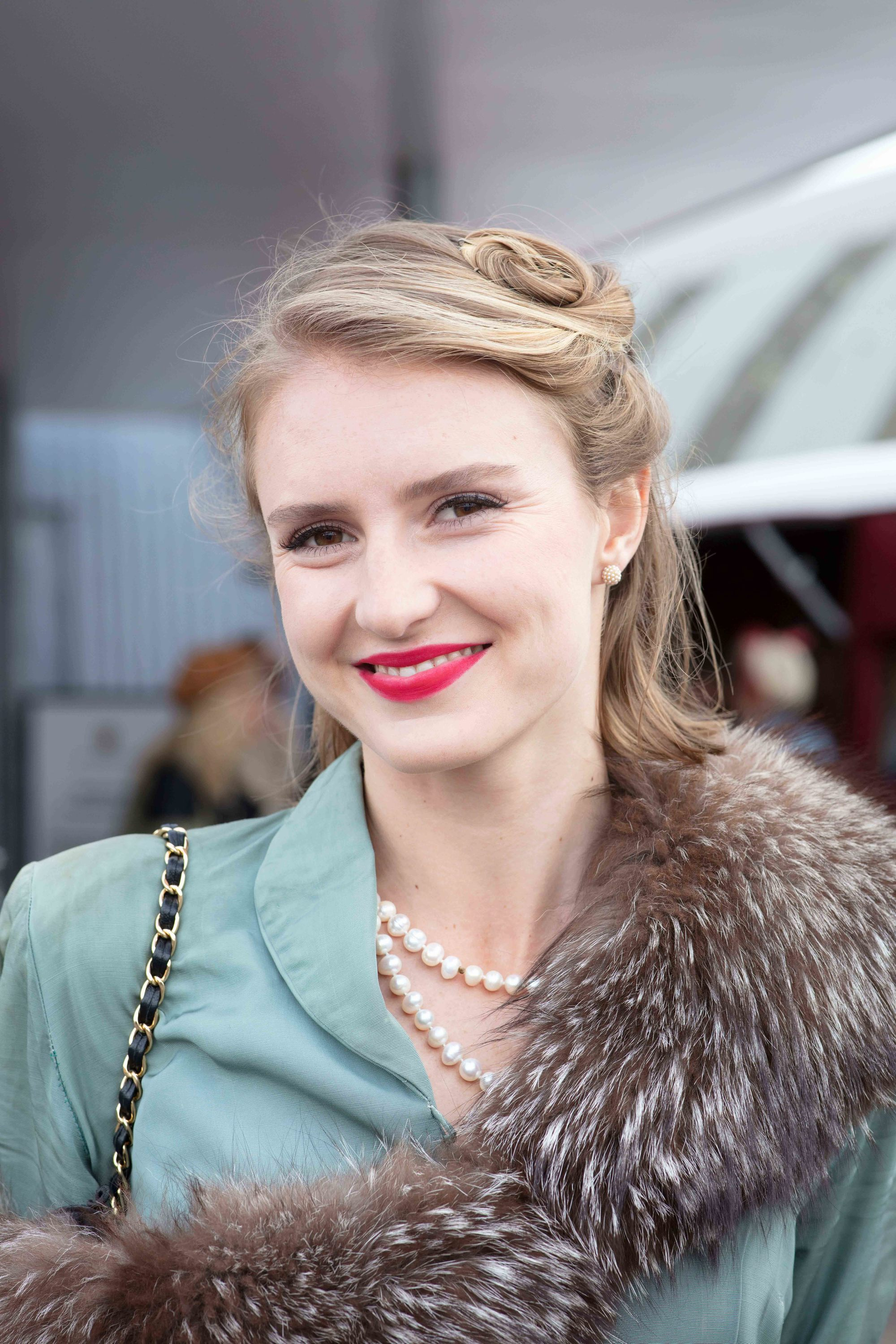 Pin up hairstyles: Blonde at Goodwood Revival with bob length hair and victory rolls