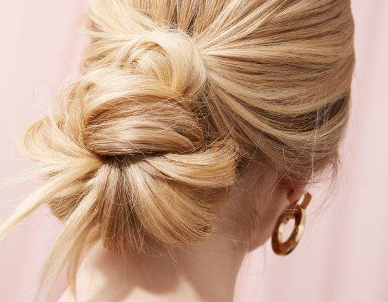 woman with long blonde hair in pinned bun updo